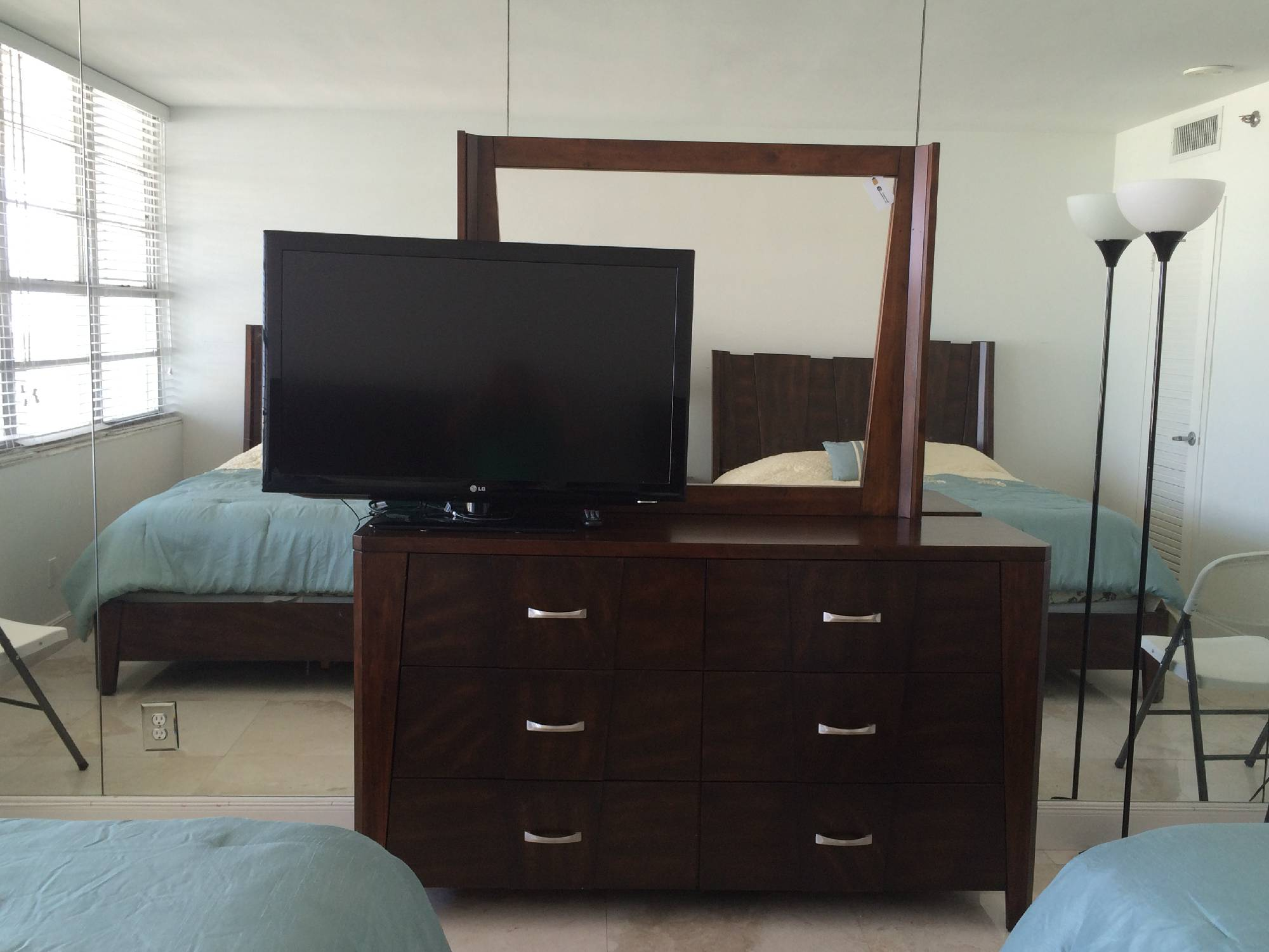 bedroom mirror and TV