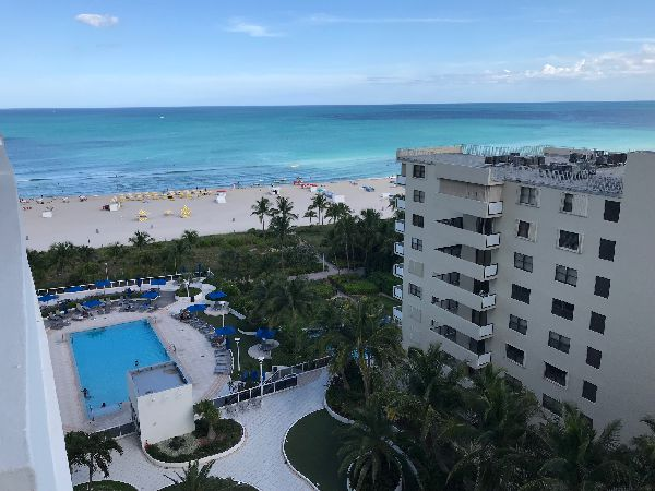 view from balcony of beach and pool